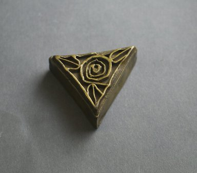 Asante. <em>Triangular Gold Weight Box with Lid</em>, 19th century. Copper alloy, 7/8 x 2 3/4 in. (2.2 x 7 cm). Brooklyn Museum, Gift of Shirley B. Williams, 1990.221.12a-b. Creative Commons-BY (Photo: Brooklyn Museum, 1990.221.12a-b_front_PS5.jpg)