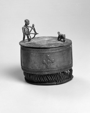 Asante. <em>Cylindrical Container with Lid (Kuduo)</em>, 19th century or earlier. Copper alloy, 5 7/8 x 5 x 5 in.  (14.9 x 12.7 x 12.7 cm). Brooklyn Museum, Gift of Shirley B. Williams, 1990.221.2a-b. Creative Commons-BY (Photo: Brooklyn Museum, 1990.221.2a-b_view1_bw.jpg)