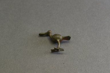 Akan. <em>Gold-weight (abrammuo): bird</em>, ca. 1600-1720. Copper alloy, length: 3 in. (length: 5.7 cm). Brooklyn Museum, Gift of Shirley B. Williams, 1990.221.38. Creative Commons-BY (Photo: Brooklyn Museum, 1990.221.38_front_PS5.jpg)