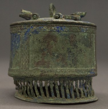 Asante. <em>Cylindrical Container with Lid  (Kuduo)</em>, 19th century. Copper alloy, height (maximum): 3 1/2 in. Brooklyn Museum, Gift of Shirley B. Williams, 1990.221.3a-b. Creative Commons-BY (Photo: Brooklyn Museum, 1990.221.3a-b_PS10.jpg)