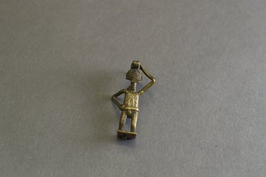 Akan. <em>Gold-weight (abrammuo): male figure</em>, ca. 1700-1900. Copper alloy, length: 3 in. (length: 4.9 cm). Brooklyn Museum, Gift of Shirley B. Williams, 1990.221.45. Creative Commons-BY (Photo: Brooklyn Museum, 1990.221.45_front_PS5.jpg)