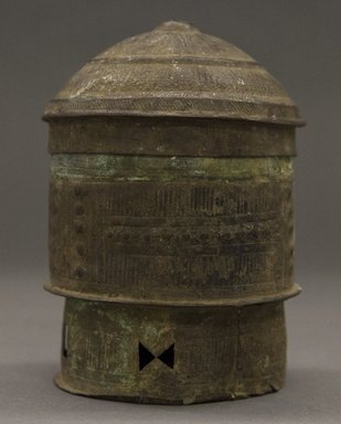 Asante. <em>Cylindrical Container with Domed Lid</em>, 19th century. Copper alloy, height: 4 3/4 in. Brooklyn Museum, Gift of Shirley B. Williams, 1990.221.4a-b. Creative Commons-BY (Photo: Brooklyn Museum, 1990.221.4a-b_PS10.jpg)