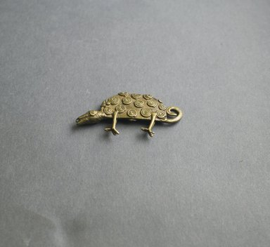 Akan. <em>Gold-weight (abrammuo): chameleon</em>, ca. 1700-1900. Copper alloy, length: 3 in. (length: 7.0 cm. Brooklyn Museum, Gift of Shirley B. Williams, 1990.221.58. Creative Commons-BY (Photo: Brooklyn Museum, 1990.221.58_PS5.jpg)