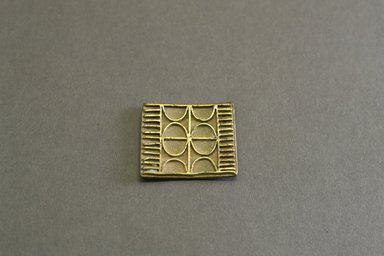 Akan. <em>Gold-weight (abrammuo): geometric</em>, 19th century. Copper alloy, width: 1 1/2 in. (height: .2 cm. Brooklyn Museum, Gift of Shirley B. Williams, 1990.221.69. Creative Commons-BY (Photo: Brooklyn Museum, 1990.221.69_front_PS5.jpg)