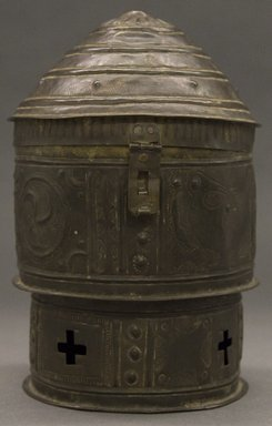 Asante. <em>Cylindrical Container with Domed Lid  (Forowa)</em>, 19th century. Hammered sheets of riveted copper alloy, height: 9 1/2 in. Brooklyn Museum, Gift of Shirley B. Williams, 1990.221.6a-b. Creative Commons-BY (Photo: Brooklyn Museum, 1990.221.6a-b_PS10.jpg)