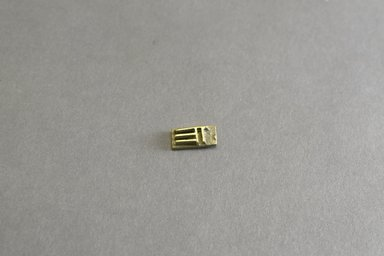 Akan. <em>Gold-weight (abrammuo): geometric</em>, 19th century. Copper alloy, width: 1 1/2 in. (height: .5 cm. Brooklyn Museum, Gift of Shirley B. Williams, 1990.221.75. Creative Commons-BY (Photo: Brooklyn Museum, 1990.221.75_front_PS5.jpg)
