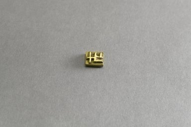 Akan. <em>Gold-weight (abrammuo): geometric</em>, 19th century. Copper alloy, width: 3/4 in. (height: .6 cm. Brooklyn Museum, Gift of Shirley B. Williams, 1990.221.81. Creative Commons-BY (Photo: Brooklyn Museum, 1990.221.81_front_PS5.jpg)