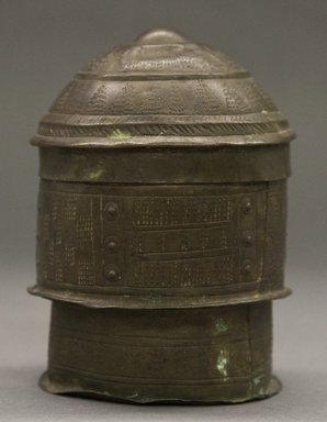 Asante. <em>Cylindrical Container with Domed Lid  (Forowa)</em>, 19th century. Hammered sheets of copper alloy, height: 5 in. Brooklyn Museum, Gift of Shirley B. Williams, 1990.221.8a-b. Creative Commons-BY (Photo: Brooklyn Museum, 1990.221.8a-b_PS10.jpg)