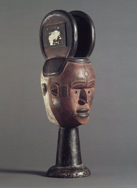 Nupe. <em>Janus-faced Dance Crest for Ekeleke Performance</em>, 20th century. Wood, glass mirror, pigment, 21 1/2 x 8 1/2 x 8 in. (54.6 x 21.6 x 20.3 cm). Brooklyn Museum, Gift of Ruth E. Wilner, 1990.222.2. Creative Commons-BY (Photo: Brooklyn Museum, 1990.222.2_side.jpg)