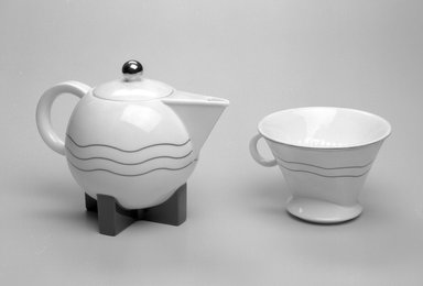 Michael Graves (American, 1934-2015). <em>Coffee Pot with Lid and Drip Spout</em>, Designed 1987; Manufactured 1989-1990. Porcelain, Coffee Pot & Lid (a & b): 7 x 9 1/4 x 5 3/4 in. (17.8 x 23.5 x 14.6 cm). Brooklyn Museum, Gift of Swid Powell, 1990.34.1a-c. Creative Commons-BY (Photo: Brooklyn Museum, 1990.34.1a-c_view1_bw.jpg)