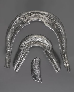 <em>Saddle Ornaments</em>, 10th century. Silver, metalwork, a: 11 1/2 x 13 1/2 x 1 1/2 in. (29.2 x 34.3 x 3.8 cm). Brooklyn Museum, Purchased with funds given by Mr. and Mrs. Herbert Irving, 1990.72a-c. Creative Commons-BY (Photo: Brooklyn Museum, 1990.72a-c_edited_PS9.jpg)