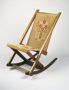 George Jacob Hunzinger (American, born Germany, 1835-1898). <em>Folding Rocking Chair</em>, ca. 1870. Walnut, brass, original upholstery, 31 3/4 x 17 7/8 x 29in. (80.6 x 45.4 x 73.7cm). Brooklyn Museum, George C. Brackett Fund, 1991.102. Creative Commons-BY (Photo: Brooklyn Museum, 1991.102_IMLS_SL2.jpg)