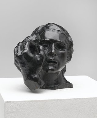 Auguste Rodin (French, 1840-1917). <em>Small Head of Jean de Fiennes with Left Hand (Petite tête de Jean de Fiennes avec main gauche)</em>, model date unknown; cast 1985. Bronze, 3 x 3 x 3 in. (7.6 x 7.6 x 7.6 cm). Brooklyn Museum, Gift of Cantor Fitzgerald, Inc., 1991.108.2. Creative Commons-BY (Photo: Brooklyn Museum, 1991.108.2_PS2.jpg)