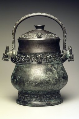 <em>You Vessel and Lid</em>, ca. 16th-11th century B.C.E. Bronze, Height with handle in raised position: 13 1/4 in. (33.7 cm). Brooklyn Museum, Gift of Alan and Simone Hartman, 1991.127.3a-b. Creative Commons-BY (Photo: Brooklyn Museum, 1991.127.3a-b.jpg)