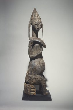 Bamana. <em>Figure of a Seated Female (Gwadnusu)</em>, 19th century. Wood, 42 1/8 x x 9 1/16 x 11 1/2 in. (107.0 x 23.0 x 29.1 cm). Brooklyn Museum, Gift of Corice and Armand P. Arman, 1991.169.1. Creative Commons-BY (Photo: Brooklyn Museum, 1991.169.1.jpg)
