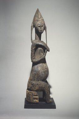 Bamana. <em>Figure of a Seated Female (Gwadnusu)</em>, 19th century. Wood, 42 1/8 x x 9 1/16 x 11 1/2 in. (107.0 x 23.0 x 29.1 cm). Brooklyn Museum, Gift of Corice and Armand P. Arman, 1991.169.1. Creative Commons-BY (Photo: Brooklyn Museum, 1991.169.1.jpg)