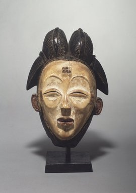 Punu. <em>Mask (Okuyi)</em>, late 19th-early 20th century. Wood, pigment, 11 1/2 x 8 9/16 x 7 3/8 in. (29.2 x 21.7 x 18.7 cm). Brooklyn Museum, Gift of Corice and Armand P. Arman, 1991.169.2. Creative Commons-BY (Photo: Brooklyn Museum, 1991.169.2.jpg)