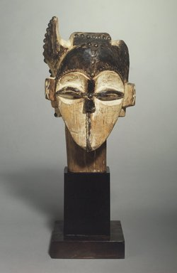 Fang. <em>Marionette Head?</em>, 19th century. Wood, metal, pigment, 12 5/16 x 6 9/16 x 5 15/16 in. (31.2 x 16.7 x 15.0 cm). Brooklyn Museum, Gift of Corice and Armand P. Arman, 1991.169.3. Creative Commons-BY (Photo: Brooklyn Museum, 1991.169.3.jpg)