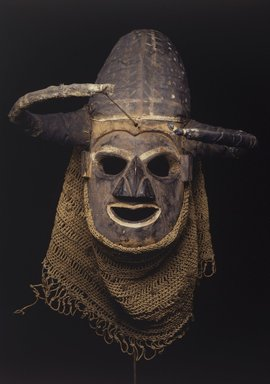 Yaka. <em>Anthropomorphic Mask</em>, early 20th century. Wood, cloth, raffia fiber, pigment, reed, 16 5/8 x 17 1/4 in. (42.2 x 43.8 cm). Brooklyn Museum, Gift of Ruth Lippman, 1991.172.1. Creative Commons-BY (Photo: Brooklyn Museum, 1991.172.1.jpg)
