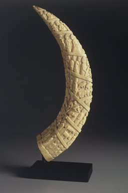 Vili artist. <em>Souvenir Ivory with Figurative Motifs</em>, late 19th century. Hippopotamus tooth, graphite, 16 x 3 x 6 3/4 in. (40.6 x 7.6 x 17.1 cm). Brooklyn Museum, Purchase gift of Mrs. Arthur G. Cohen, 1991.176. Creative Commons-BY (Photo: Brooklyn Museum, 1991.176.jpg)