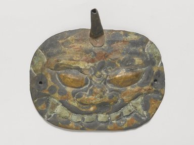 <em>Monster Mask</em>, 3rd century or earlier. Mottled bronze, 6 x 4 1/2 x 7/8 in. (15.3 x 11.4 x 2.3 cm). Brooklyn Museum, Gift of Bernice and Robert Dickes, 1991.179.2. Creative Commons-BY (Photo: Brooklyn Museum, 1991.179.2_PS4.jpg)