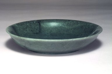 <em>Shallow Dish</em>, 18th-19th century. Mottled green jade (jadeite), 1 1/2 x 7 1/2 in. (3.8 x 19.1 cm). Brooklyn Museum, Gift of Mrs. Louis Nathanson, 1991.183. Creative Commons-BY (Photo: Brooklyn Museum, 1991.183.jpg)