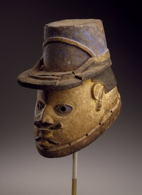 Yorùbá. <em>Gelede Helmet Mask of a Gendarme</em>, early 20th century. Wood, metal, pigment, 10 x 7 x 11 in. (25.4 x 17.8 x 27.9 cm). Brooklyn Museum, Gift of Eugene and Harriet Becker, 1991.226.3. Creative Commons-BY (Photo: Brooklyn Museum, 1991.226.3_SL3.jpg)