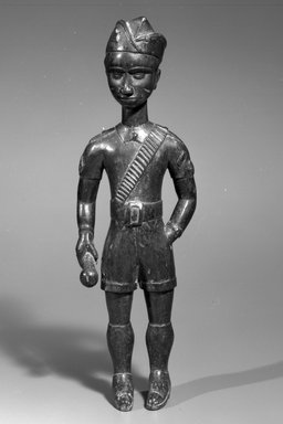 Baule. <em>Male Figure (Blolo bian)</em>, 20th century. Wood, patina, 15 x 4 3/4 x 2 7/8 in. Brooklyn Museum, Gift of Mr. and Mrs. Joseph Gerofsky, 1991.229.3. Creative Commons-BY (Photo: Brooklyn Museum, 1991.229.3_bw.jpg)