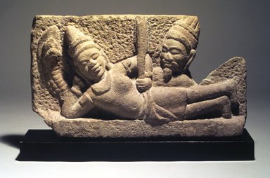 Cham. <em>Vishnu Reclining on Sesha</em>, 750-950. Grey sandstone, 9 3/8 x 17 3/8 in. (23.8 x 44.0 cm). Brooklyn Museum, Gift of Georgia and Michael de Havenon, 1991.239. Creative Commons-BY (Photo: Brooklyn Museum, 1991.239.jpg)