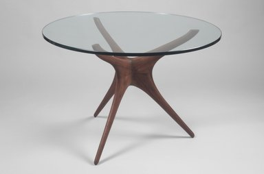 Vladimir Kagan (American, born Germany, 1927-2016). <em>Tri-symmetric Sculptured Table</em>, ca. 1953. Walnut, glass, (base): 27 9/16 x 25 1/2 x 25 1/2 in. (70 x 64.8 x 64.8 cm). Brooklyn Museum, Gift of the artist, 1991.255.1a-b. Creative Commons-BY (Photo: Brooklyn Museum, 1991.255.1a-b.jpg)