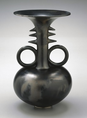 Magdalene Anyango N. Odundo (British, born Kenya 1950). <em>Symmetrical Reduced Black Narrow-Necked Tall Piece</em>, 1990. Terracotta, 16 x 10 x 10 in. (40.6 x 25.4 x 25.4 cm). Brooklyn Museum, Purchased with funds given by Dr. and Mrs. Sidney Clyman and Frank L. Babbott Fund, 1991.26. © artist or artist's estate (Photo: Brooklyn Museum, 1991.26_SL1.jpg)
