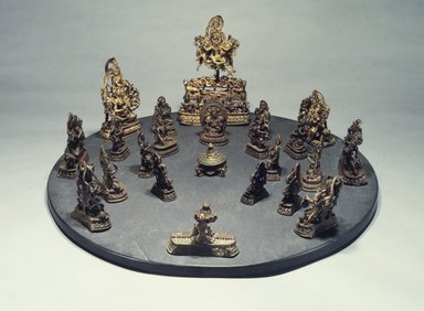 <em>Four Armed Male Divinity Seated on a Corpse from a Brahmanical  Tantric Mandala</em>, 17th century. Bronze, 3 3/4 x 1 7/8 x 1 5/8 in. Brooklyn Museum, Gift of Harry Kahn, 1991.27.15. Creative Commons-BY (Photo: , 1991.27.1-.24.jpg)