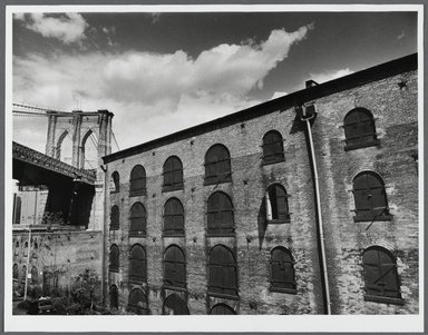 Tony Velez (American, born 1946). <em>Brooklyn Bridge and Empire Stores (Warehouse), Brooklyn, NY.</em>, 1990. Gelatin silver photograph, Image: 10 x 13 1/2 in. (25.4 x 34.3 cm). Brooklyn Museum, Gift of Paul Velez, 1991.308.14. © artist or artist's estate (Photo: Brooklyn Museum, 1991.308.14_PS1.jpg)
