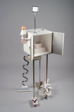 "Peter Shire (American, born 1947). <em>""Ode to a Soapstone Monkey"" Cabinet-on-Stand</em>, 1988. SURREL (TM) solid surfacing material, Colorcore (TM), metal, porcelain, fluorescent bulb, Overall: 69 7/8 x 31 1/2 x 30 in. (177.5 x 80 x 76.2 cm). Brooklyn Museum, Gift of Formica Corporation, 1991.6.1a-d. Creative Commons-BY (Photo: Brooklyn Museum, 1991.6.1a-d_open.jpg)"