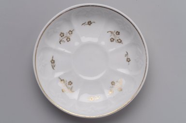 Attributed to Charles Cartlidge & Co. (1848-1856). <em>Saucer</em>, ca. 1850. Porcelain, gilt, 1 x 5 11/16 x 5 11/16 in. (2.5 x 14.4 x 14.4 cm). Brooklyn Museum, Gift of George West, 1991.98. Creative Commons-BY (Photo: Brooklyn Museum, 1991.98.jpg)