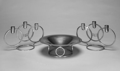 "Walter Dorwin Teague (American, 1883-1960). <em>Candelabrum, One of Pair, ""Classique Modern,""</em> Introduced 1934. Pewter, 6 9/16 x 10 1/8 x 4 5/16 in.  (16.7 x 25.7 x 11.0 cm). Brooklyn Museum, Marie Bernice Bitzer Fund, 1993.78.3. Creative Commons-BY (Photo: , 1992.102_1993.78.3_1993.78.4_bw.jpg)"