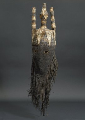 Salampasu. <em>Mask for the Idangani Society, Akish</em>, early 20th century. Cloth, pigment, wicker, fiber, 31 1/2 x 8 1/16 x 7 1/16 in. (80 x 20.4 x 18 cm). Brooklyn Museum, Gift of Corice and Armand P. Arman, 1992.133.1. Creative Commons-BY (Photo: Brooklyn Museum, 1992.133.1_SL1.jpg)