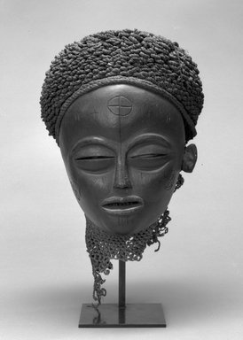 Chokwe. <em>Mask (Mwana Pwo)</em>, early 20th century. Wood, fiber, metal, 12 x 8 1/2 x 9 in. (30.5 x 21.5 x 22.7 cm). Brooklyn Museum, Gift of Corice and Armand P. Arman, 1992.133.3. Creative Commons-BY (Photo: Brooklyn Museum, 1992.133.3_view1_bw.jpg)