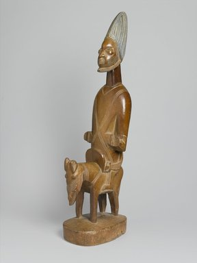 Yorùbá. <em>Figure of Shango on Horseback</em>, early 20th century. Wood, pigment, 40 x 14 1/2 x 9 in. (101.6 x 36.8 x 22.9 cm). Brooklyn Museum, Gift of Corice and Armand P. Arman, 1992.133.4. Creative Commons-BY (Photo: Brooklyn Museum, 1992.133.4_threequarter_PS1.jpg)