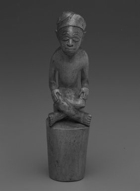 Kongo. <em>Male Figure with Crossed Legs</em>, early 20th century. Wood, 5 3/4 x 1 1/8 x 1 1/2in. (14.6 x 2.9 x 3.8cm). Brooklyn Museum, Gift of Drs. Noble and Jean Endicott, 1992.136.16. Creative Commons-BY (Photo: Brooklyn Museum, 1992.136.16_bw.jpg)