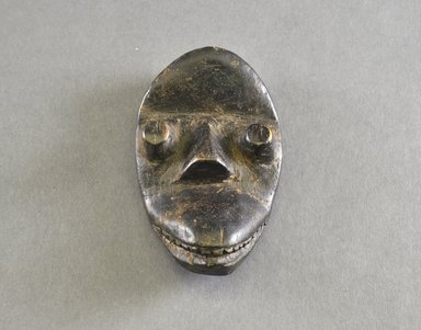 Dan. <em>Personal Miniature Mask</em>, late 19th or early 20th century. Wood, pigment, 4 1/4 x 2 1/2 in. (10.8 x 6.4 cm). Brooklyn Museum, Gift of Drs. Noble and Jean Endicott, 1992.136.4. Creative Commons-BY (Photo: Brooklyn Museum, 1992.136.4_front_PS5.jpg)