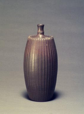 <em>Wine Bottle</em>, late 18th-early 19th century. Glazed stoneware: Bizen ware, Imbe style, Height: 9 3/4 in. - Diameter: 3 3/4 in. Brooklyn Museum, Gift of Mrs. John M. Lyden, 1992.148.2. Creative Commons-BY (Photo: Brooklyn Museum, 1992.148.2.jpg)