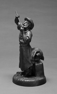 Karl L. H. Mueller (American, born Germany, 1820-1887). <em>Statuette of Blacksmith</em>, ca. 1867. Patinated metal, 10 15/16 x 5 3/8 x 5 3/8 in.  (27.8 x 13.7 x 13.7 cm). Brooklyn Museum, Gift of Emma and Jay Lewis, 1992.163.1. Creative Commons-BY (Photo: Brooklyn Museum, 1992.163.1_bw.jpg)