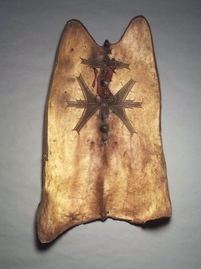Tuareg. <em>Shield</em>, late 19th-early 20th century. Hide, metal, cloth, 51 x 30 in.  (129.5 x 76.2 cm). Brooklyn Museum, Gift of Blake Robinson, 1992.196.1. Creative Commons-BY (Photo: Brooklyn Museum, 1992.196.1_transpc001.jpg)