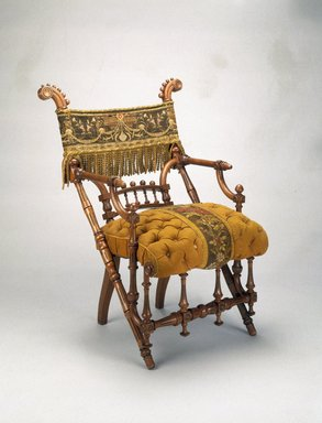 George Jacob Hunzinger (American, born Germany, 1835-1898). <em>Armchair</em>, designed: 1869; patented: March 30, 1869. Wood, original upholstery, 35 5/8 x 27 1/4 x 25 1/2 in.  (90.5 x 69.2 x 64.8 cm). Brooklyn Museum, H. Randolph Lever Fund, 1992.208. Creative Commons-BY (Photo: Brooklyn Museum, 1992.208_IMLS_SL2.jpg)