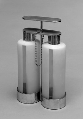 Russel Wright (American, 1904-1976). <em>Tantalus Decanter Set: Holder, Two Decanters, Two Caps, Lock, Key</em>, ca. 1930. Chromed brass, colorless and frosted glass, white metal, 11 11/16 x 7 3/8 x 3 5/8 in.  (29.7 x 18.7 x 9.2 cm). Brooklyn Museum, Marie Bernice Bitzer Fund, 1992.247a-g. Creative Commons-BY (Photo: Brooklyn Museum, 1992.247a-g_bw.jpg)