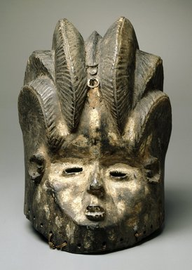 Bassa. <em>Sande society mask (gonde)</em>, 19th or 20th century. Wood, pigment, kaolin, metal, fiber, 13 x 9 x 9 in. (33.0 x 22.9 x 22.9 cm). Brooklyn Museum, Gift of Blake Robinson, 1992.26.4. Creative Commons-BY (Photo: Brooklyn Museum, 1992.26.4_SL1.jpg)