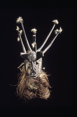 Manding. <em>Men's Society Mask</em>, 19th-20th century. Wood, metal, cowrie shells, mirror, fur, cord, fiber, cloth, feather fragments, 50 in. (127 cm). Brooklyn Museum, Gift of Blake Robinson, 1992.26.6. Creative Commons-BY (Photo: Brooklyn Museum, 1992.26.6_transpc002.jpg)