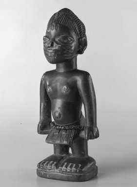 Yorùbá artist. <em>Male twin figure (Ère Ìbejì)</em>, early 20th century. Wood, glass beads, nails, 8 x 2 1/2in. (20.3 x 6.4cm). Brooklyn Museum, Gift of the David and Margery Edwards Collection, 1992.67.2. Creative Commons-BY (Photo: Brooklyn Museum, 1992.67.2_bw.jpg)