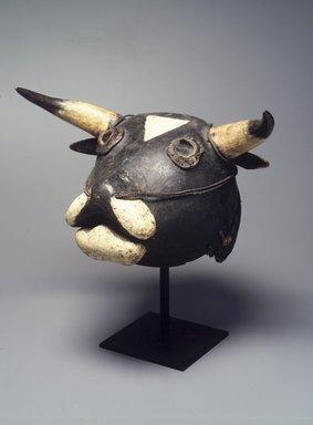 Bijagó. <em>Ox Mask (Dugn'be)</em>, 20th century. Wood, raffia, bone, glass, metal, fur, paint, fiber, 15 1/2 x 19 x 9in. (39.4 x 48.3 x 22.9cm). Brooklyn Museum, Gift of Mr. and Mrs. Joseph Gerofsky, 1992.69.3. Creative Commons-BY (Photo: Brooklyn Museum, 1992.69.3_transp499.jpg)